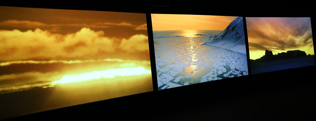 "Installation view of ""Vertigo Sea"", a three-channel video by John Akomfrah (UK)."