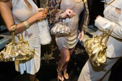 Jackie and friends with Versace handbags at a private opening at the Versace store, Beverly Hills, California, 2007. © Lauren Greenfield (image from the Annenberg Space for Photography exhibition, Generation Wealth by Lauren Greenfield)