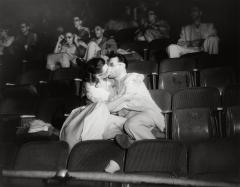 Weegee, [Woman and man kissing at movies, New York], ca. 1943. © Weegee/International Center of Photography