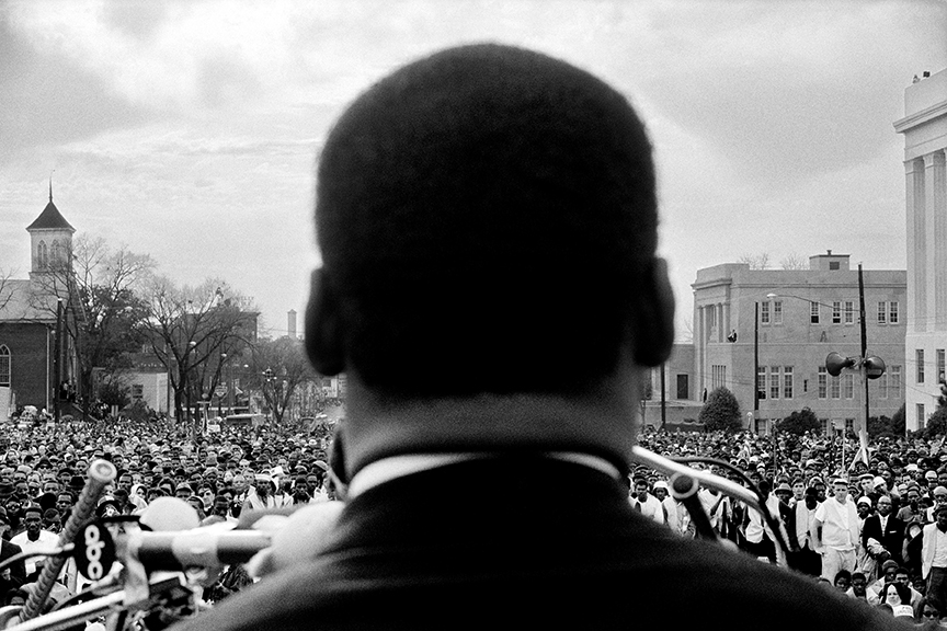 Stephen Somerstein, Dr. Martin Luther King, Jr. Looks out at crowd in Montgomery, 1965. Courtesy of the photographer