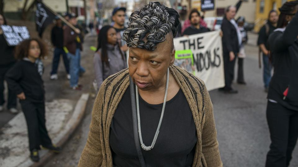 Portrait of a woman standing at a protest
