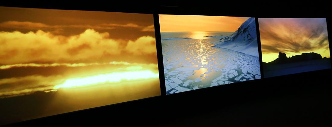 "Installation view of ""Vertigo Sea"", a three-channel video by John Akomfrah (UK)."