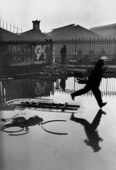 Henri Cartier-Bresson, The Decisive Moment (Simon & Schuster, 1952), p. 39, Behind the Gare St. Lazare, Place de l'Europe, Paris, France, 1932. © Henri Cartier-Bresson/Magnum Photos.